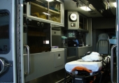 Rear view.  Monster Medic hydrolic cot, Zoll M-Series monitor with pacing, 12-lead, capnography.